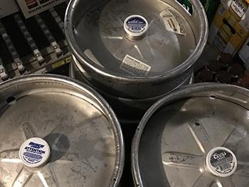 top of three kegs